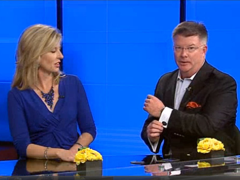 "Ted Perry shows off his new ""Studio A"" cufflinks while appearing with Katrina Cravy on WITI-TV Fox 6's ""Real Milwaukee."""
