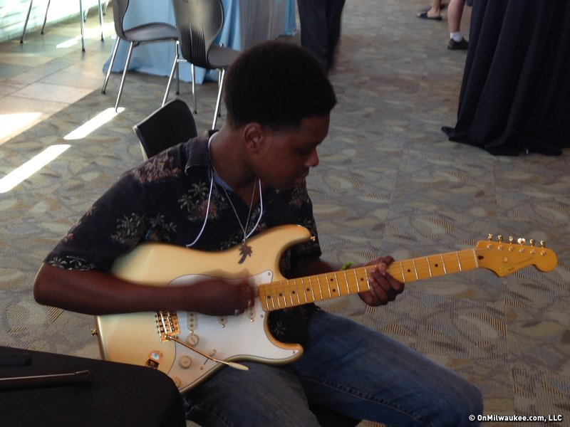 Stephen Hull, a semi-finalist, practices a little during the Wilson Center Guitar Competition and Festival.